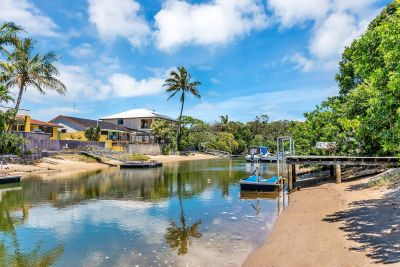 PARTLY RENOVATED LOW SET HOME WITH EXCELLENT WATER OUTLOOK! COMPLETE THE DREAM! JETTY AND JET SKI PONTOON IN PLACE!