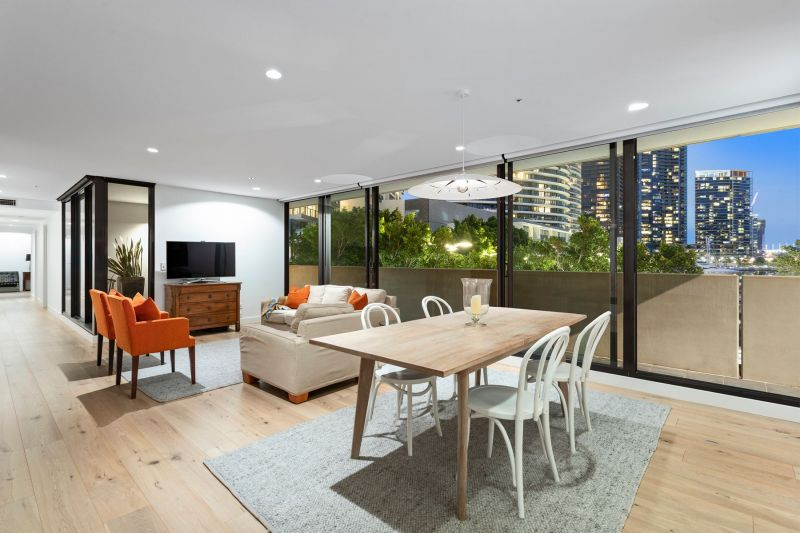 Rarely offered podium oasis with sleek renovated flair!