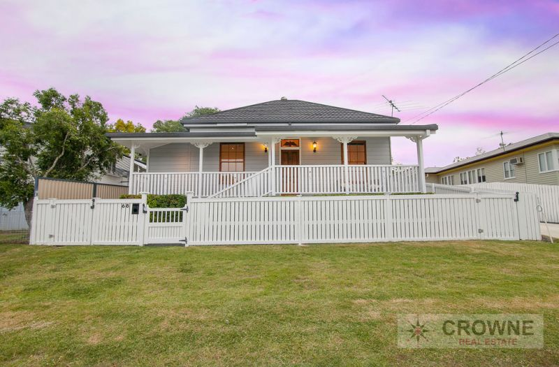 WHITE PICKET FENCE PERFECTION IN SOUGHT AFTER LOCATION