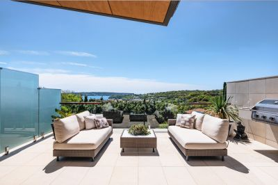 Inspiring designer retreat with views to Middle Harbour
