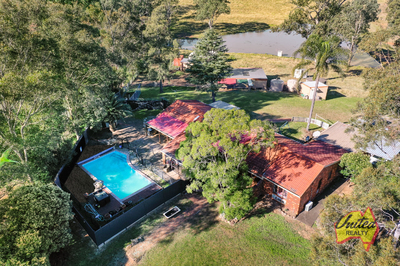 PRIVACY PLUS! 4 BEDROOMS + POOL + SHEDS + ACRES