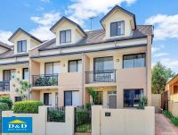 Immaculate 3 Bedroom Townhouse. Delightful Private Courtyard. Double Garage with Storage.  Quiet, Peaceful North Parramatta Location.