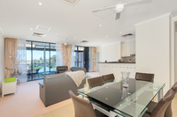 Spacious penthouse apartment boasting two balconies, open plan living and more.