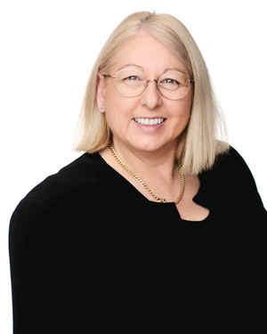 Corinne McKenzie Real Estate Agent