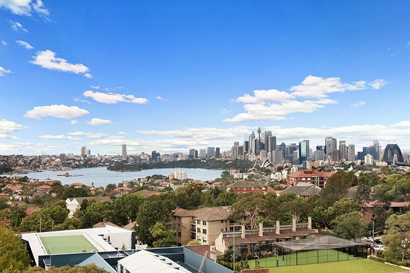 Spacious Top Floor Unit with Sweeping Harbour Views