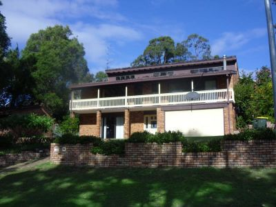 Large brick home with pool in sort after location!