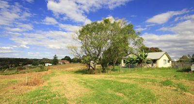perfect block  elevated setting with blue mountain views, double-road frontage, older style 3 bedroom home