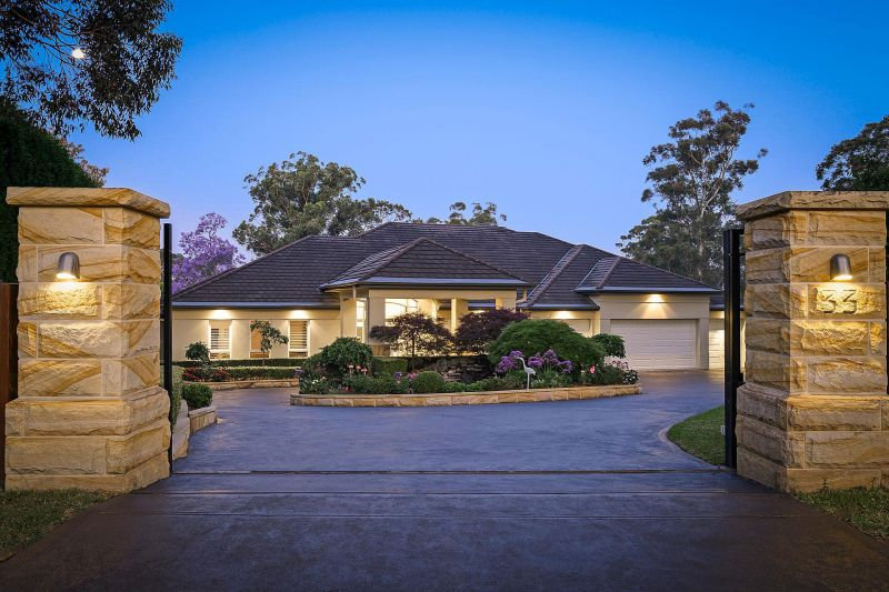 Elegance and beauty in exclusive 1 acre setting.