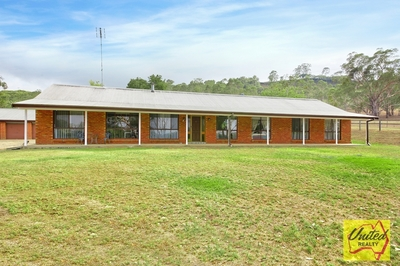 IMPRESSIVE ACREAGE PROPERTY - A MUST TO INSPECT