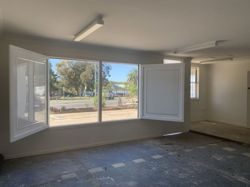 Extremely affordable highly exposed office/showroom with onsite parking
