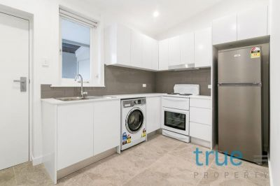 AS NEW STUDIO APARTMENT IN THE HEART OF WAREEMBA VILLAGE