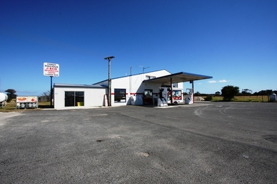 Service Station with Residence & 5 Acres of Land