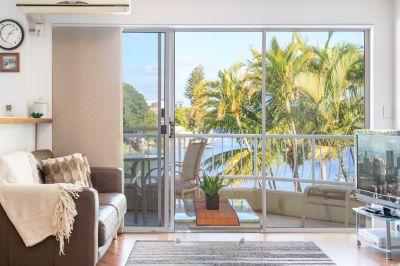 Impressive Riverfront Apartment with 2 Car Spaces + Storage