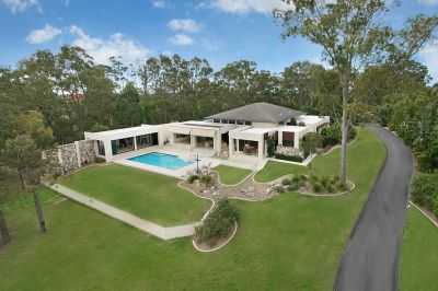 Contemporary masterpiece with sparkling lake views  rare offering in prestige Jabiru estate