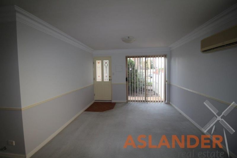 FRESHLY PAINTED, AIR CONDITIONED -WELL LOCATED SPACIOUS VILLA