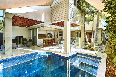 Tri-level designer home in premier beachside address
