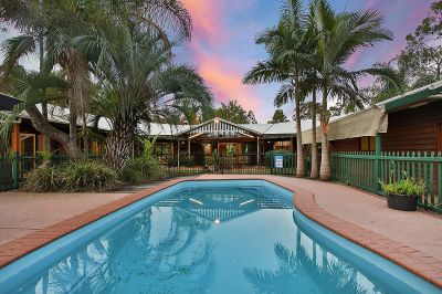 Record Sized, Sprawling Family Home Amidst Tropical Oasis!