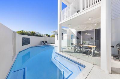 Options Aplenty With This Premium Beachfront Home