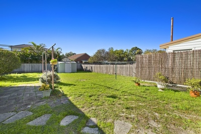 Spacious Family Home With Huge Sundrenched Backyard