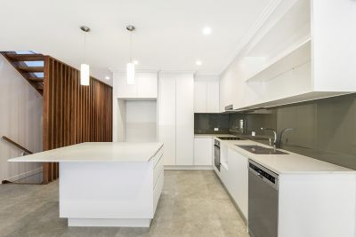 BRAND NEW DESIGNER TOWNHOUSES IN PERFECT LOCATION!