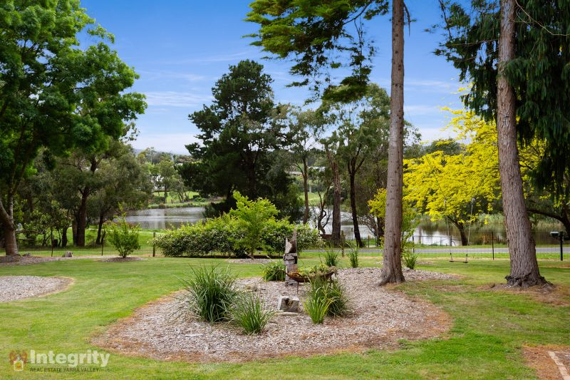 Water views, One Acre, Family Home and Shedding in the beautiful Yarra Valley.