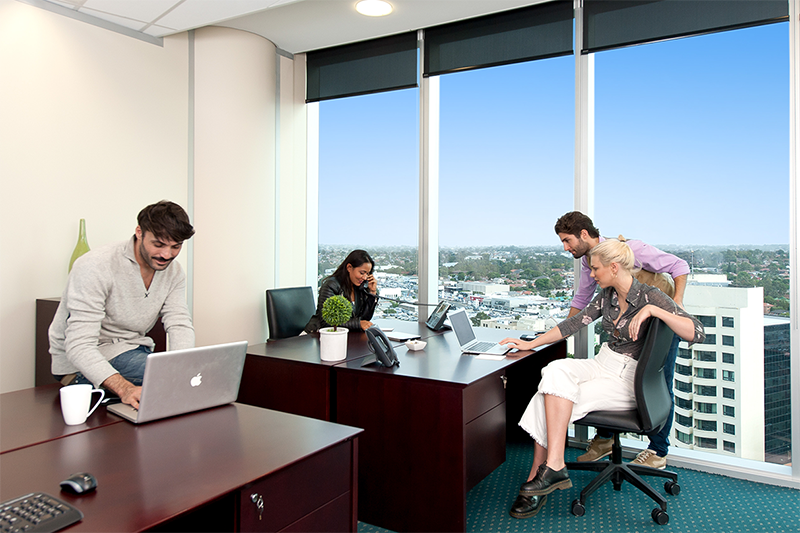 4-person workspace with abundant natural light in Nexus Norwest