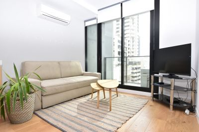 Mid Town: 6th Floor, Fully Furnished - Fantastic Inner City Apartment!