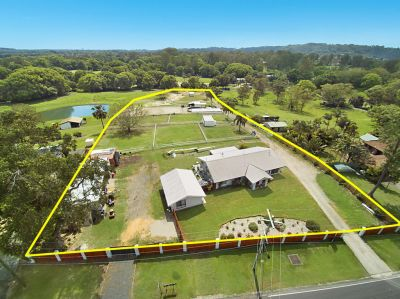 Blue chip acreage with dual living and equine facilities