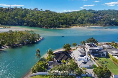 BLUE-CHIP LIFESTYLE PROPERTY WITH 50M OF PRIVATE BEACHFRONT