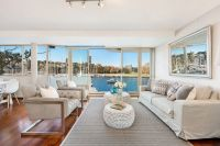 Harbourfront Apartment with Magnificent Bayside Views + Parking  Tranquil Position Footsteps to Rushcutters Bay Park