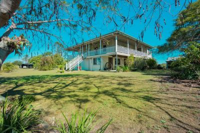 REMARKABLE QUEENSLANDER ON 9.21 ACRES CLOSE TO TOWN! POOL, SOLAR, SHEDS & DUAL LIVING OPTIONS….BE QUICK!