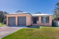 Single level brick home, walk to the waterfront