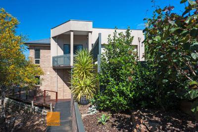 Architecturally Designed Quality Built Residence with Absolute Reserve Frontage.