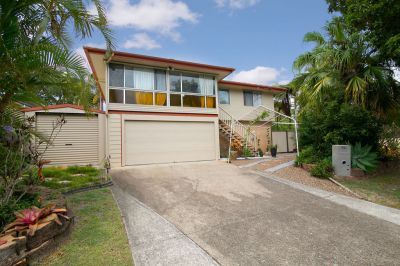 TROPICAL OASIS WITH DUAL LIVING OPPORTUNITY