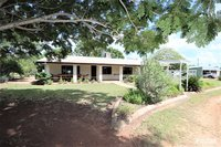8.5 ACRES - MASONRY BLOCK HOME - HORSE STABLES