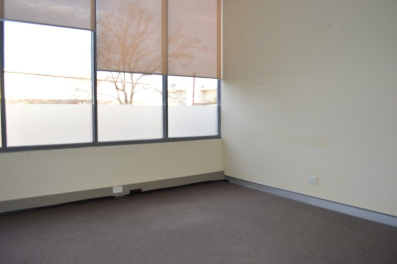 GROUND FLOOR OFFICE SUITE WITH BALCONY!
