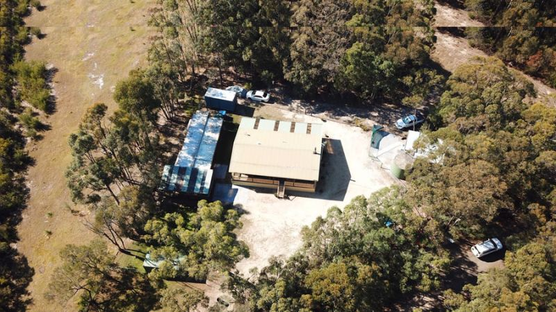 Spacious block with plenty of space for boats, cars, shedding. Private rural setting with 3 bedroom log cabin home plus 2 mobile homes.