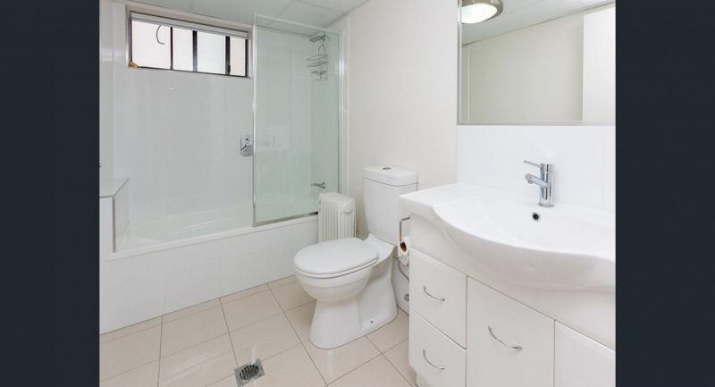 GROUND FLOOR TWO BEDROOM UNIT WITH ENSUITES AND AIR CONDITIONING IN BOTH ROOMS