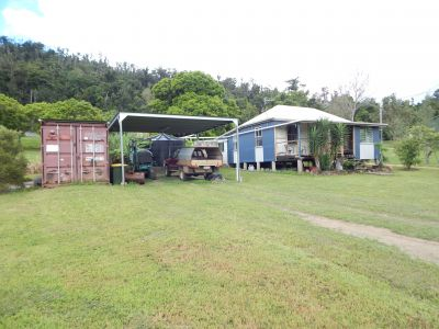 One bedroom Queenslander cottage & garage on 23 acres
