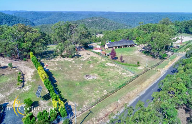 Equestrian property with farm-stay cabins, large home, quality horse facilities, mesmerizing views, and whisper quiet privacy.