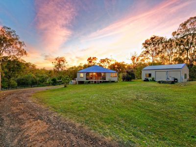 Tranquil family Oasis on 6.5 Acres + Horse Stables & Sheds!
