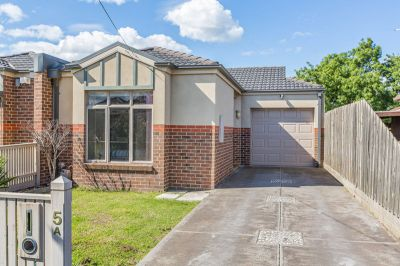 Spacious, Single Level & Superbly Located!