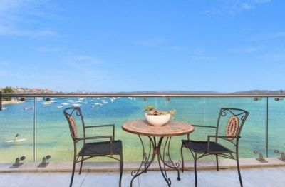 ABSOLUTE WATERFRONT, UNRENOVATED 2 BEDROOM APARTMENT